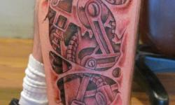 black grey robot mechanics leg tattoo guy man